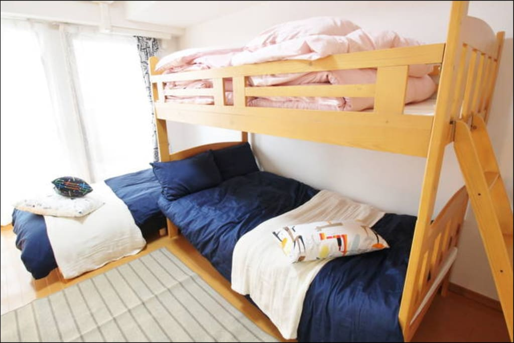 double deck bed and a single bed.