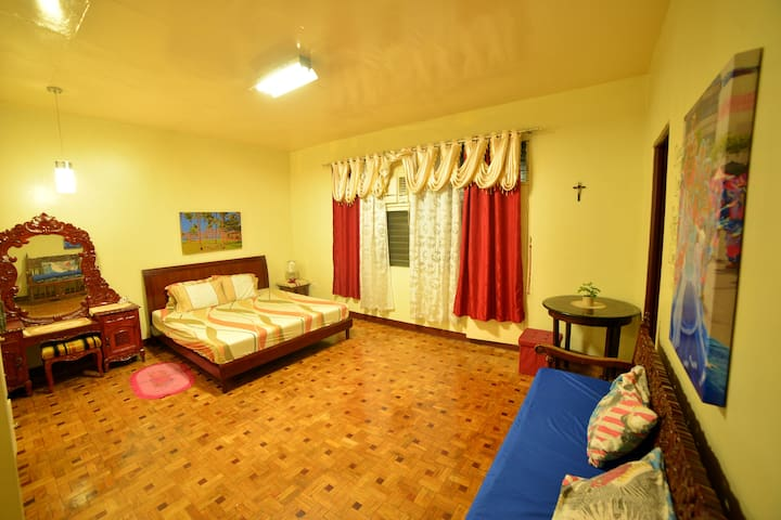 Spacious Masters Bedroom with Mahogany Tile Floor