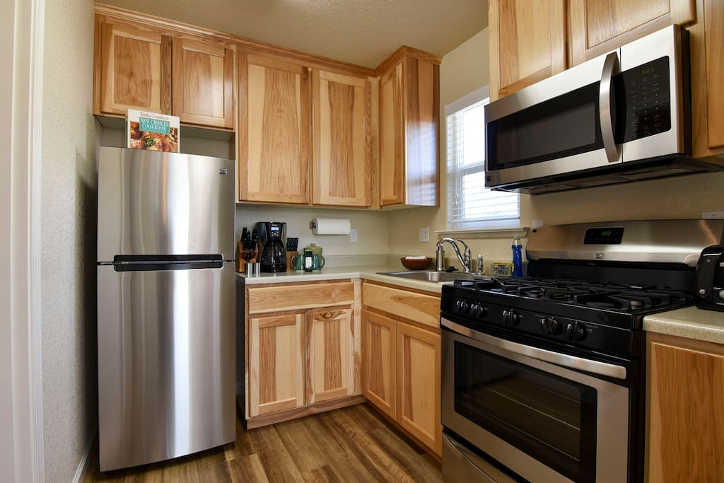 New kitchen with modern appliances.