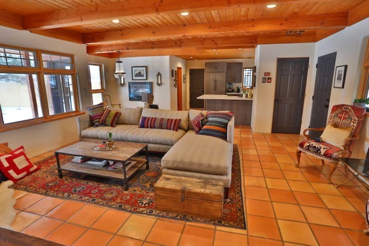 open floor plan living room with front an back porch to watch the sunsets and mountain views