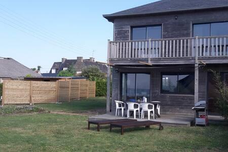 Maison en bois vue mer