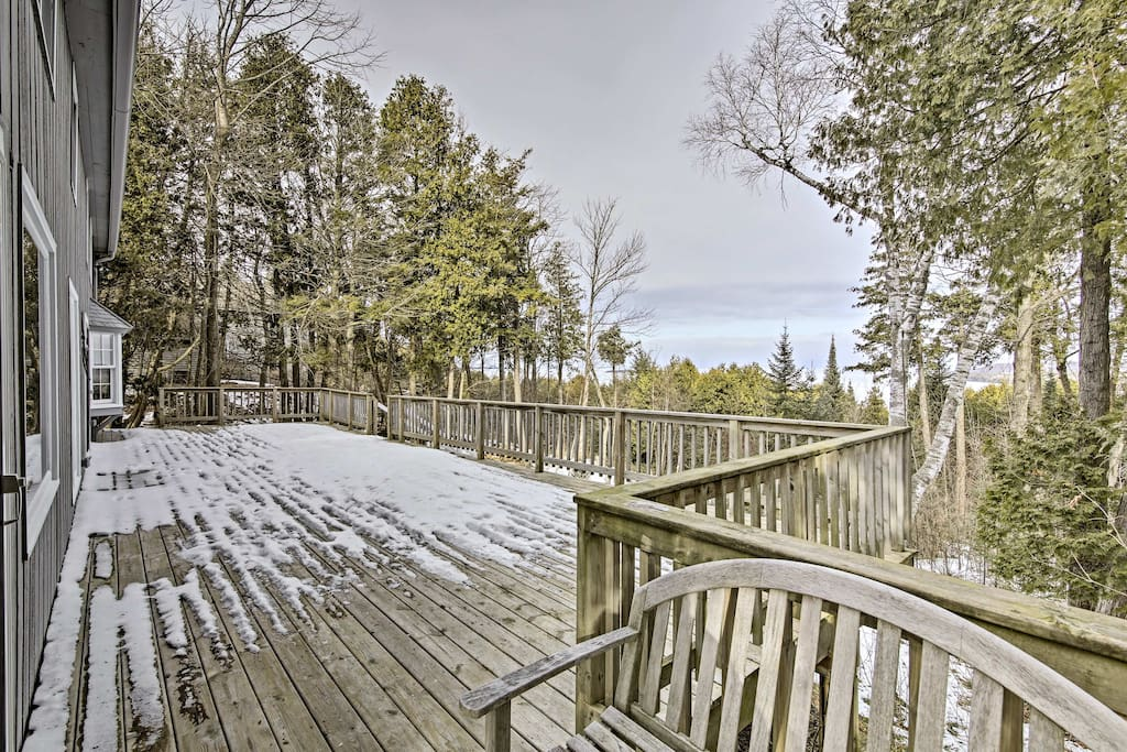 Enjoy bay views and tranquil tree-lined scenery from the back deck.