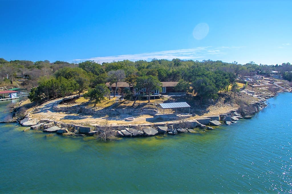 The Perfect Private Lake Retreat. Whether you want a quiet, relaxing weekend on the water or a venue for your big weekend party: this is your home! You'll have an entire peninsula on Lake Travis. 1.6 Acres of private, secluded property with massive waterfront.
