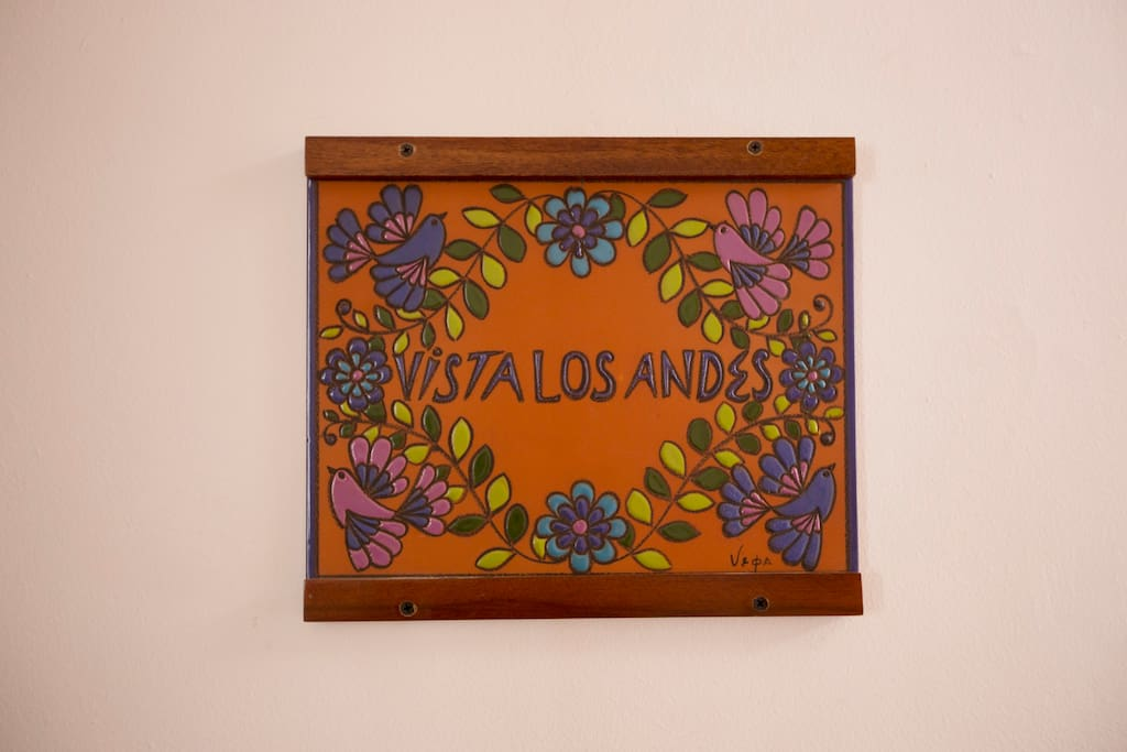 Handcrafted ceramic plaque, adorned with Ecuadorian artist design, and personalized with the apartment's name