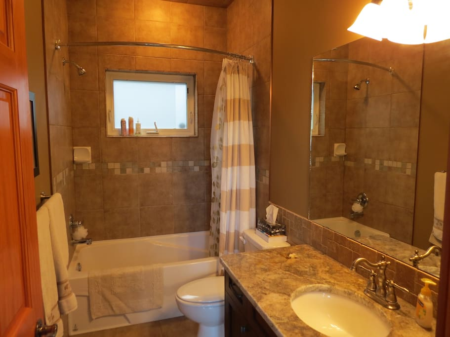 Private Bathroom with Shower, Tub, Toilet and Sink