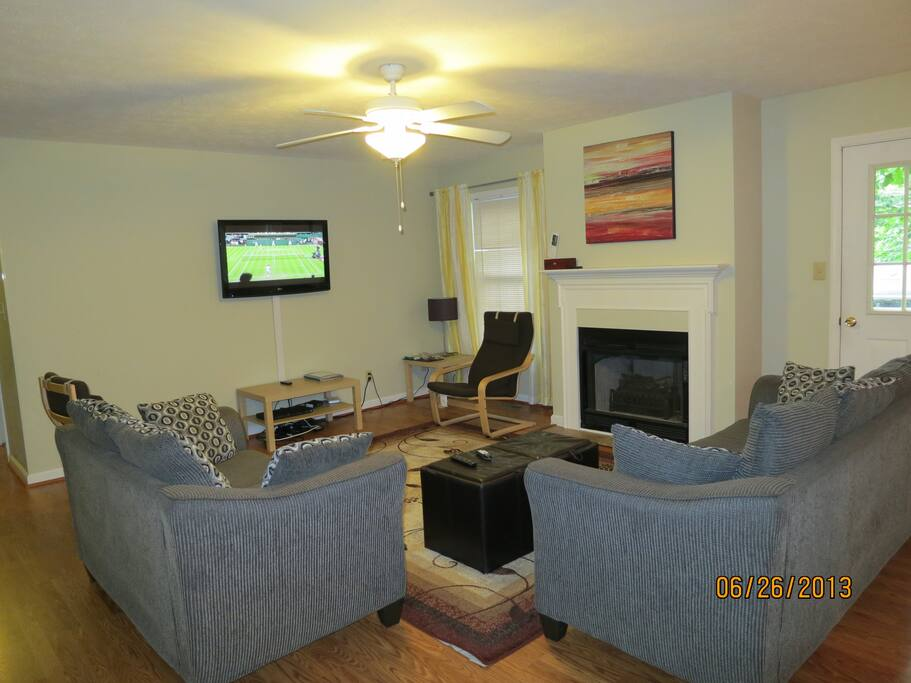 First floor living room with cozy sofas; 42in TV