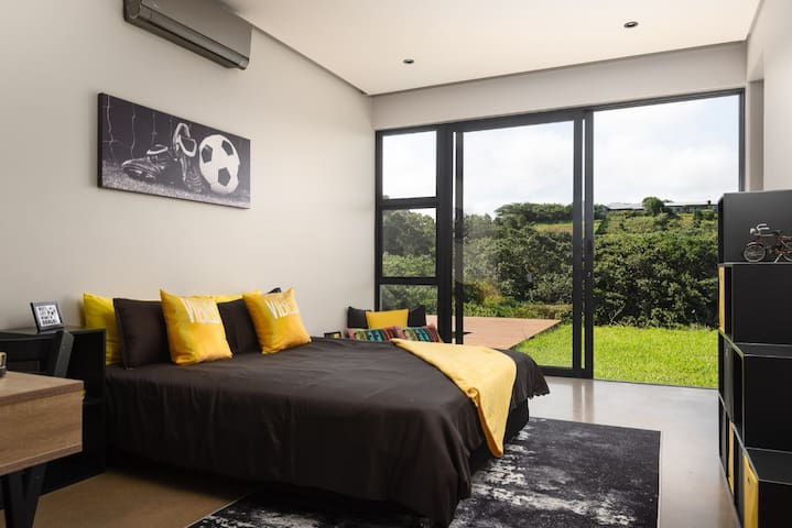 The third bedroom features a comfortable queen-size bed. All downstairs bedrooms have air-conditioning as well as  their own bathrooms and walk-in closets.