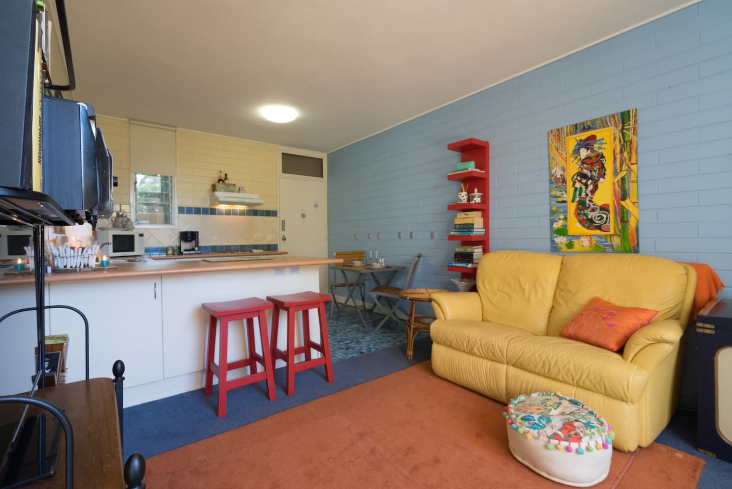 Self contained. Cosy, bright and colourful. Come in, relax and enjoy