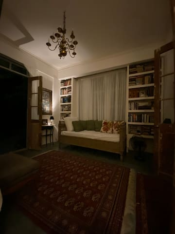 The reading room is a cosily moody room in the first floor that opens to the sala on one side, and to the back yard on the other.