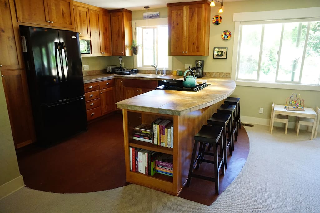 Kitchen- gas range, bar seating, open to living and dining room
