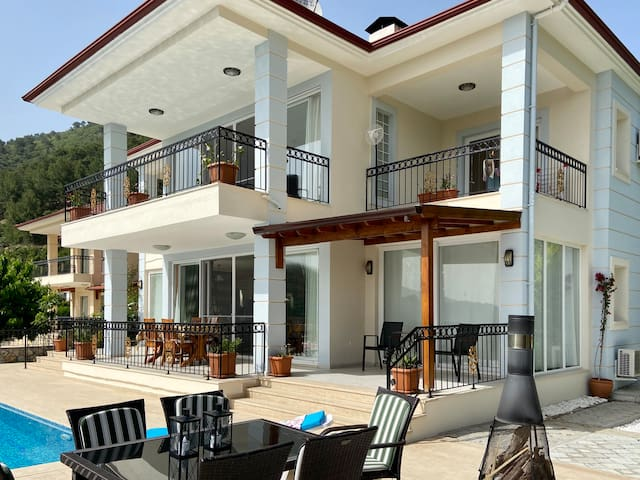 Stunning Villa with private rooms and balconies .