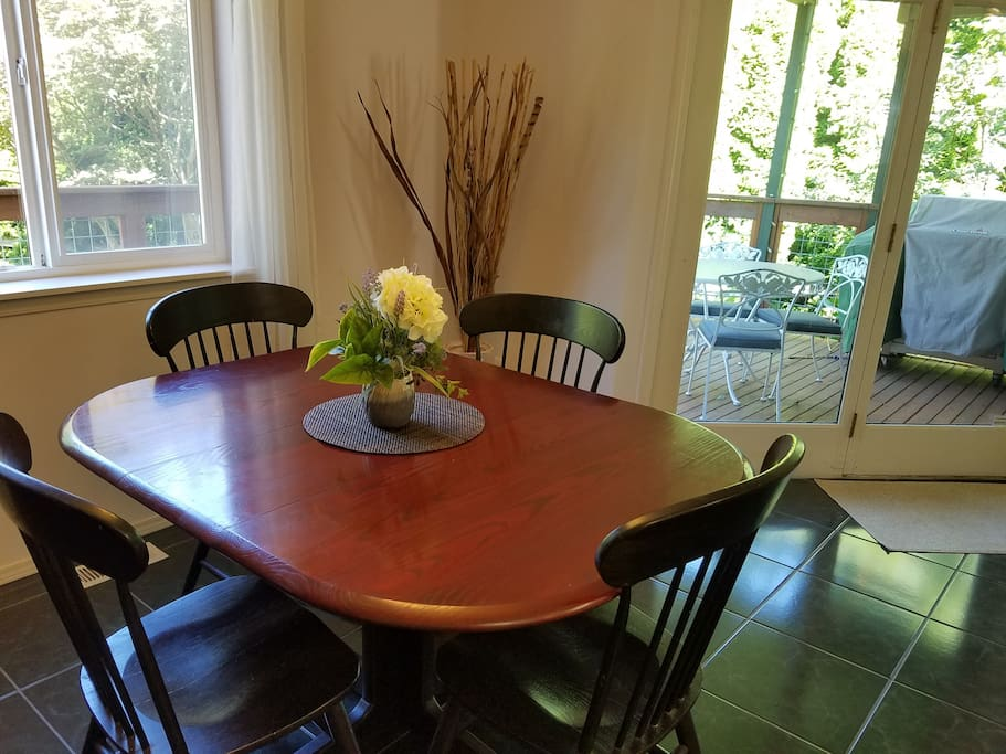 Dining table easily expands to seat 6 or more.