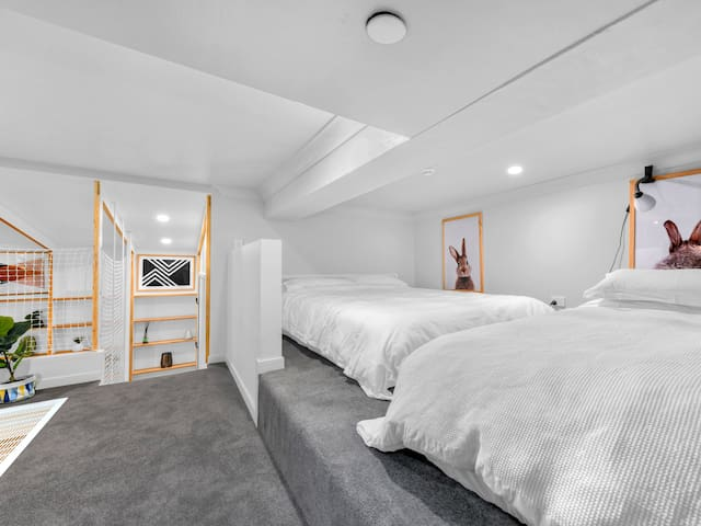 Upstairs trendy loft space with brand new queen mattress and single mattress.