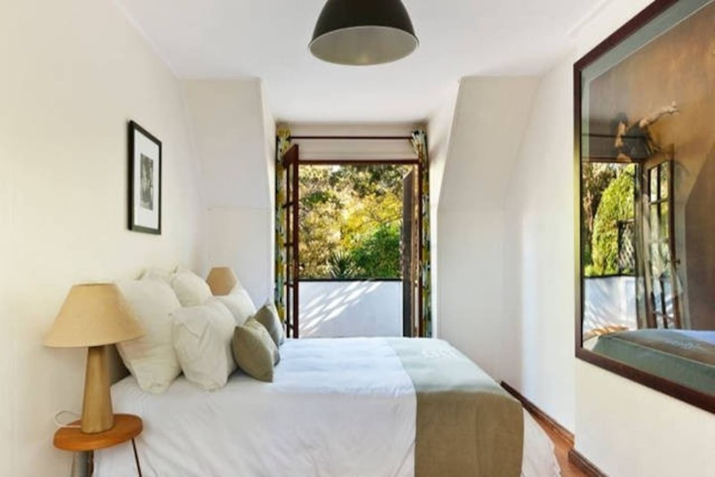 Large 2nd storey bedroom that opens to balcony overlooking the park