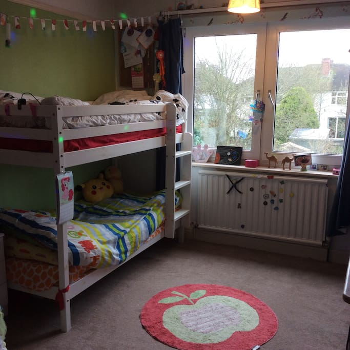 Kids room with kid size bunks and plenty of toys