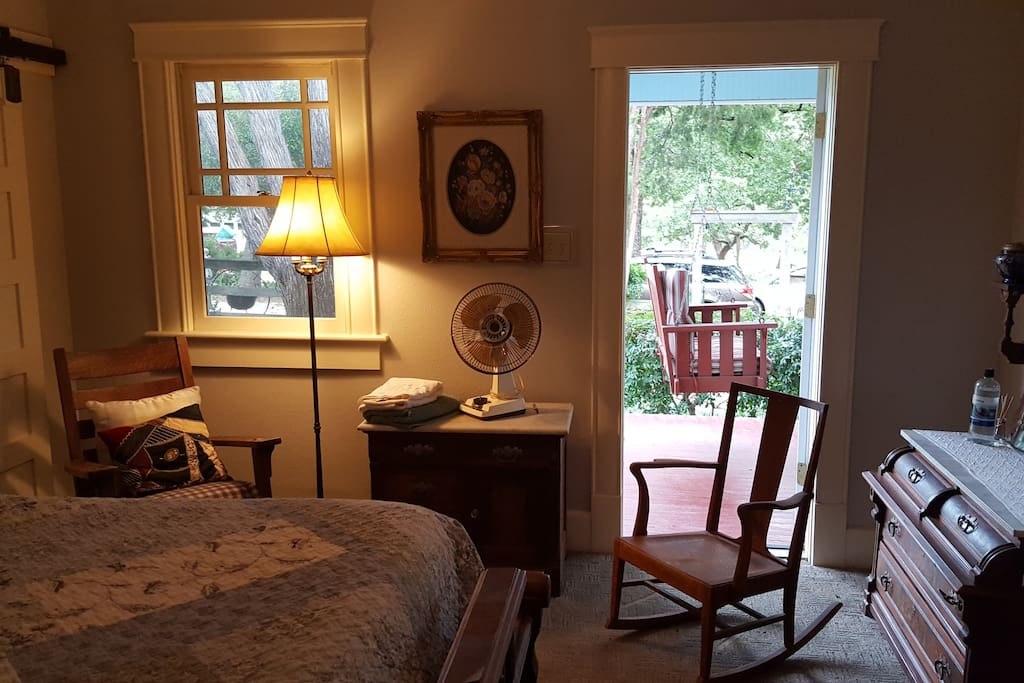 Private entrance off of wrap around covered porch allows ample privacy and easy access.  Antique furnishings complete the country vibe.
