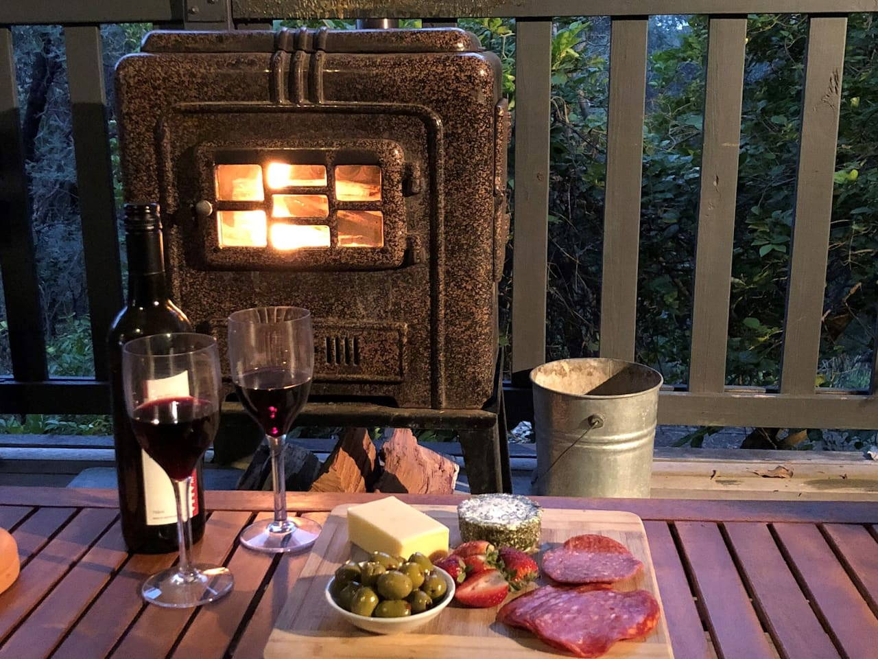 Stare into the flames and relax with a glass of wine at TreeTops.