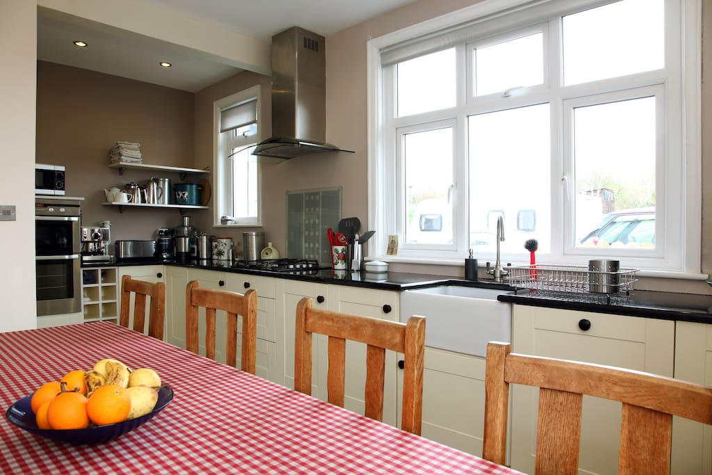 Kitchen with oven, hob, fridge, dishwasher etc., and the table can comfortably seat eight.
