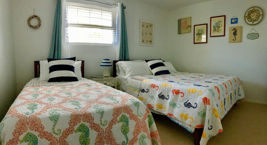 Bedroom 1 -- furnished with a twin-size bed and queen-size bed, both with comfortable, memory foam mattresses