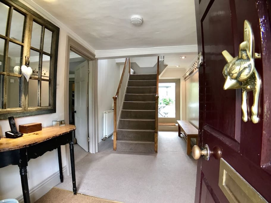 Entrance hall with plenty of coat hooks, wc under the stairs.