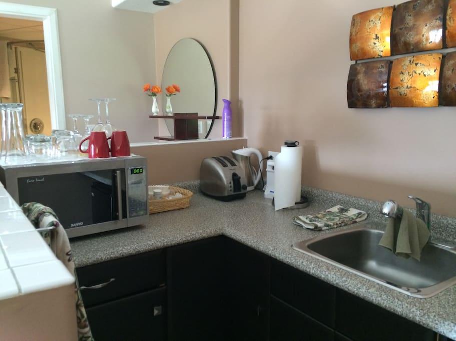 Kitchenette with mini fridge, micro wave and sink