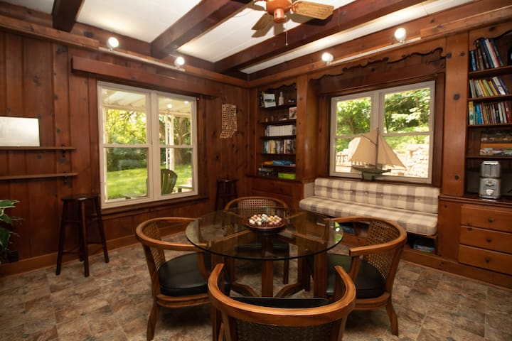 Game room on lower lower that looks out over private wooded backyard.