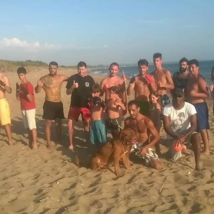 boxing club team in the beach area. They sleep in tent bungalows at Jae Academy under