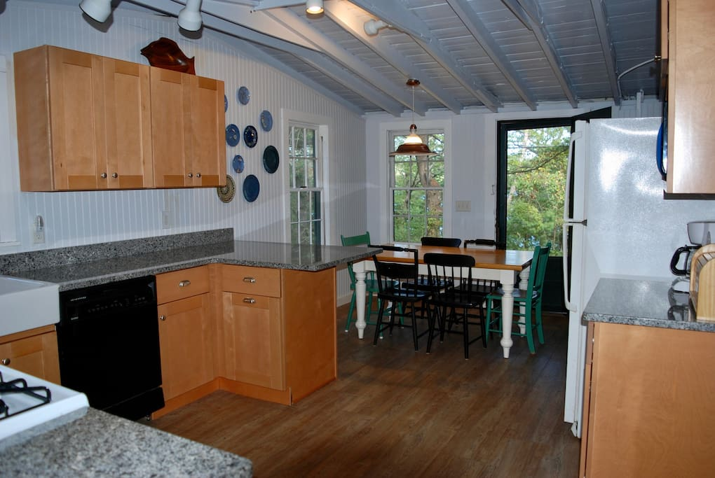 The kitchen was renovated in 2016 with new cabinets, countertops, flooring, microwave, paint and stove. We kept the summer cottage feel but made it user-friendly.