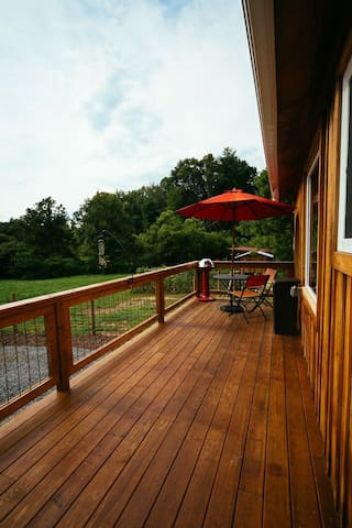 Grilling deck facing the sunset and pasture