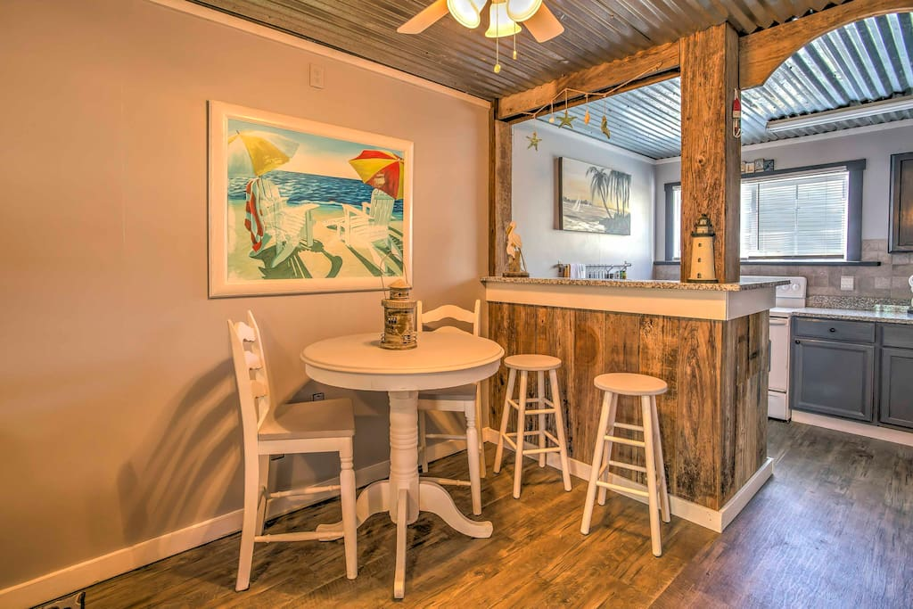Dine together at the table and kitchen bar top.