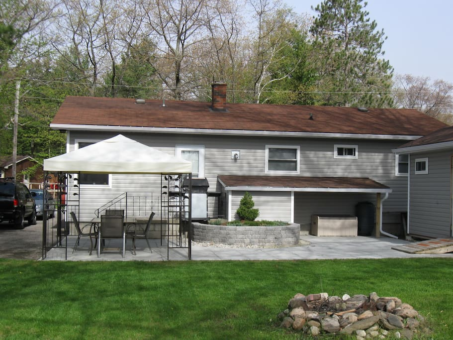 Big backyard with fire pit, and long side driveway