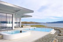 Relax in the outdoor hot tubs and infinity pool.