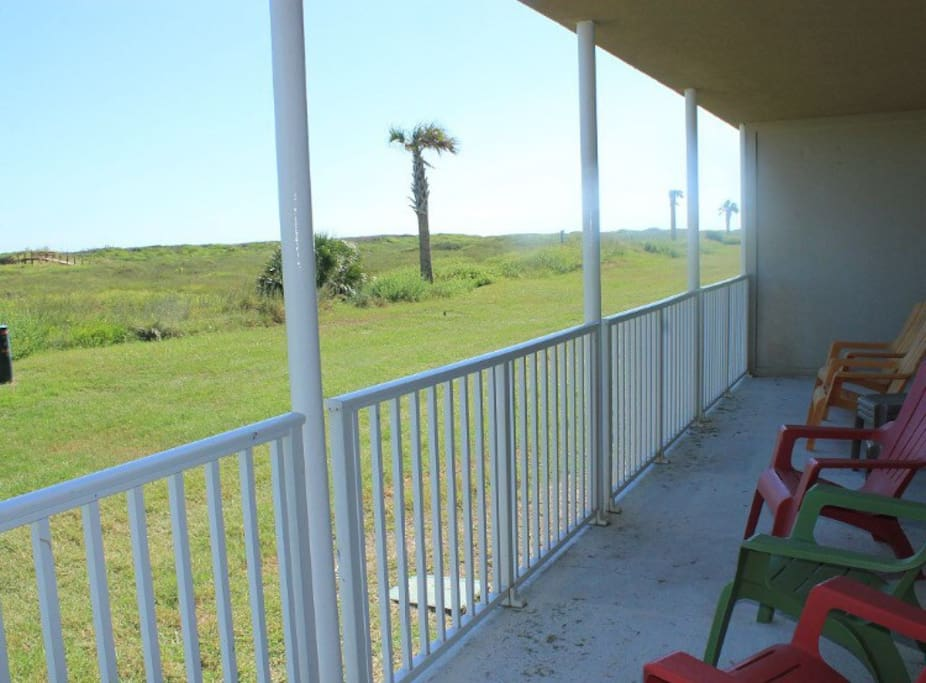 Spacious back porch. You do not see parking lots or other condos from the patio; just grass, dunes and ocean with a very private feeling.