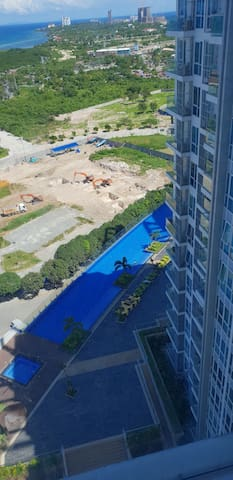 Mactan Newtown, C1-18H swimming pool and sea view.