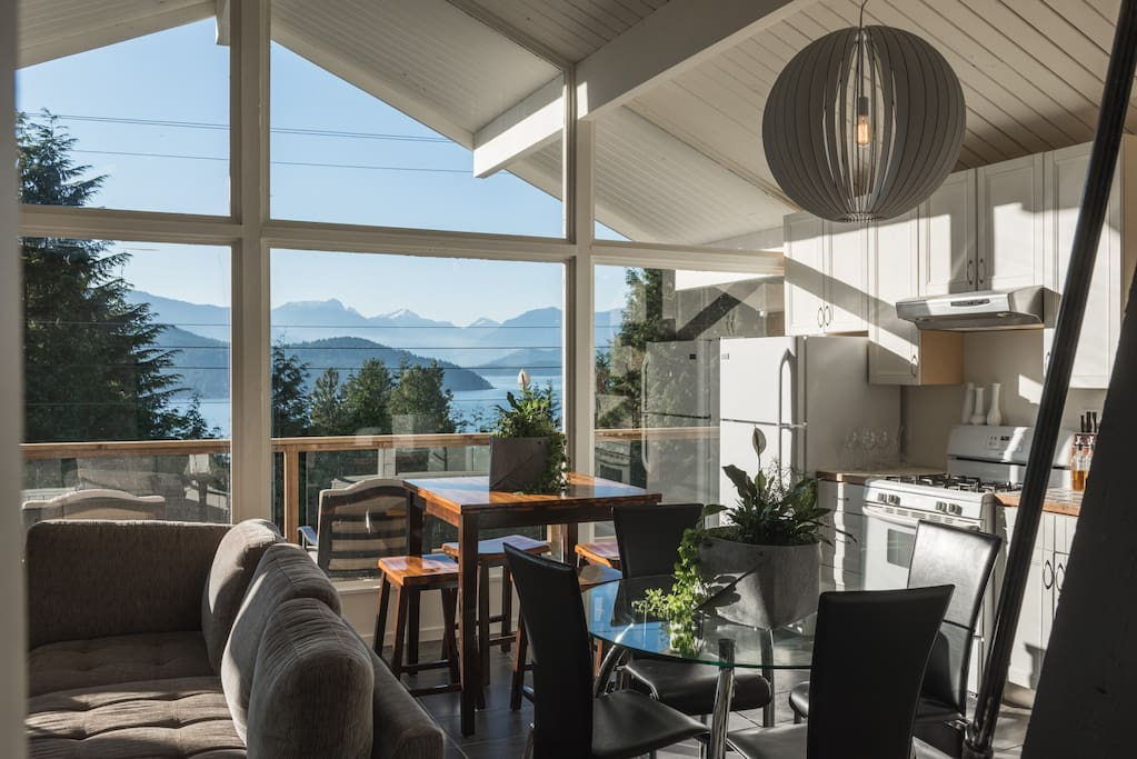 Open plan kitchen and living room with giant windows, endless views and cathedral ceilings