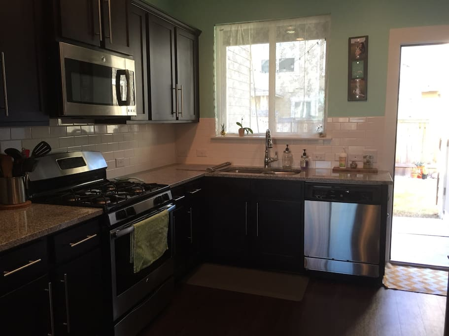 Kitchen with stove, microwave, dishwasher, fridge, and coffee maker.