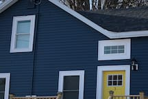 Blue house with yellow door