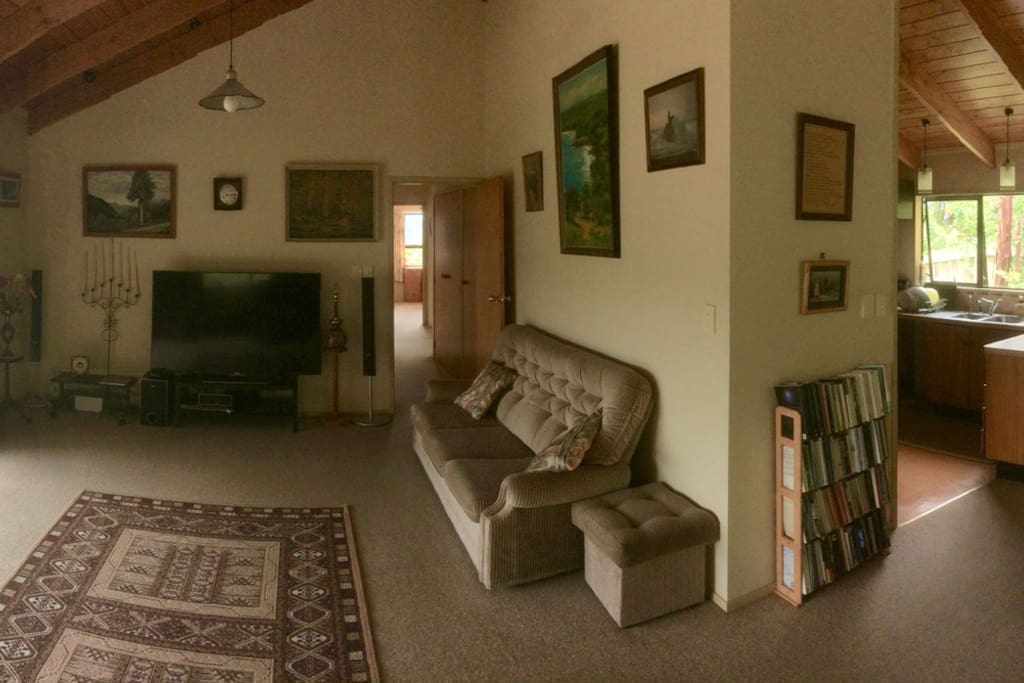 Open living space. Warm and friendly with fireplace (out of shot). Welcome to come and watch movies and sport!