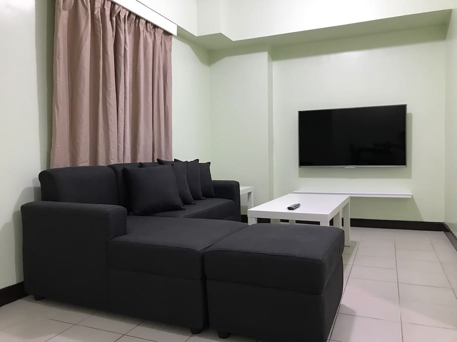Living area with 50 inch 4K TV connected to 50Mbps Internet and Cignal Cable HDTV.