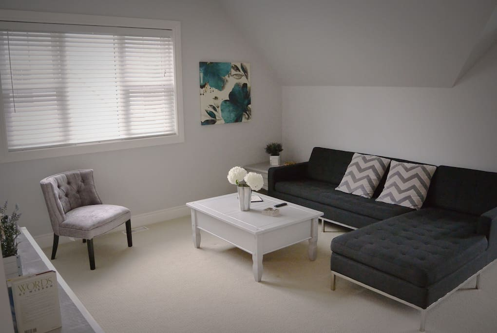 Second floor main room with large flat screen TV, ceiling fan, very spacious