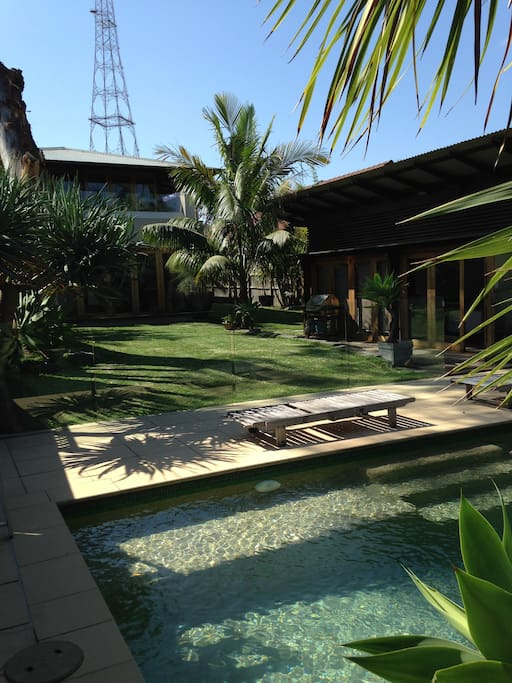 Open grass area under large gum tree immediately infront of cabin and next to pool area