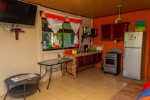 Living room and fully equipped kitchen