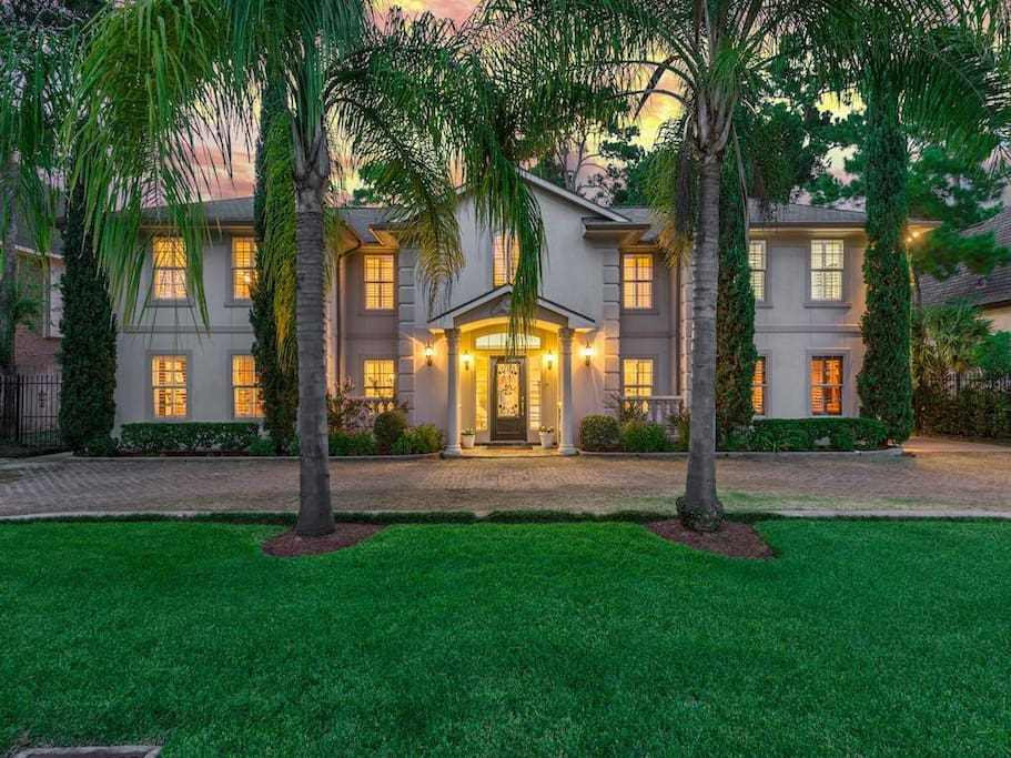 Gorgeous Stucco home with classic symmetry in the sought after Memorial Villages area.