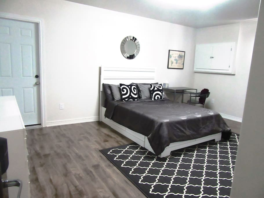 Large master's suite with very comfy queen-sized bed, a small desk, closet space and dresser.