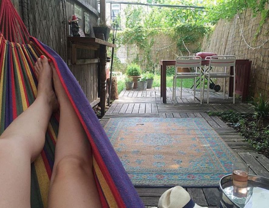 Hammocks, benches, & loungers in back yard!
