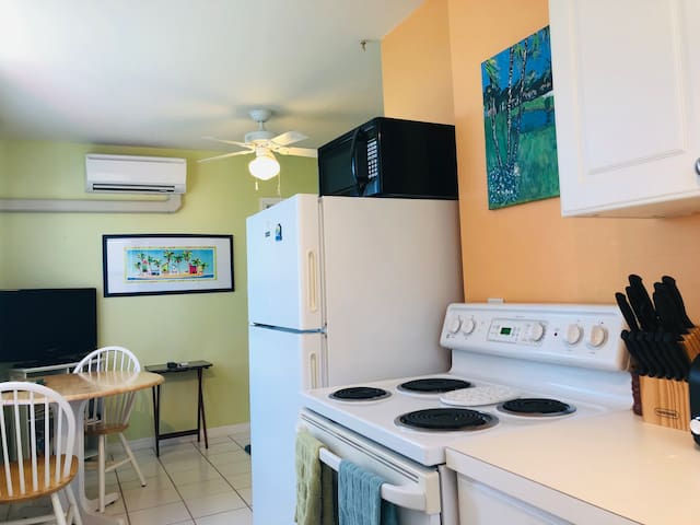 Stove, refrigerator, microwave in fully stocked kitchen