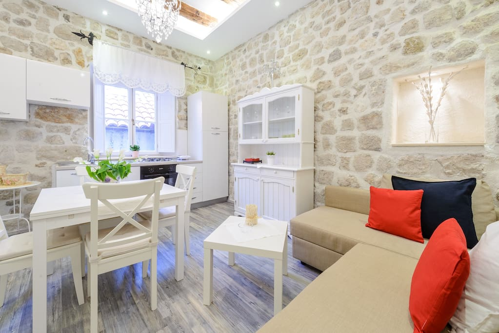 Spacious living / dining area with fully equipped kitchen, with TV SAT and air condition