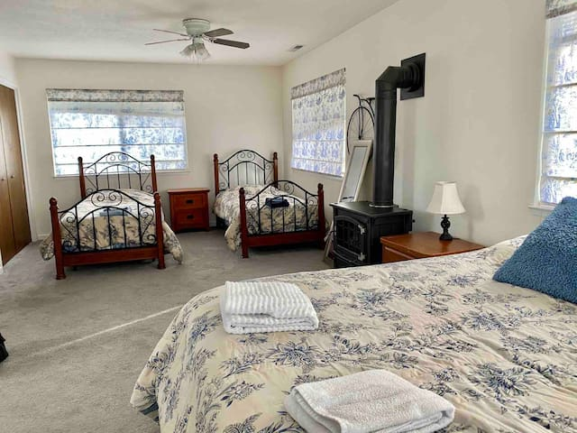 Upstairs Master bed room with 2 double and 1 queen beds