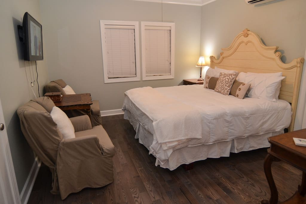 King bed with 2 comfortable chairs and table