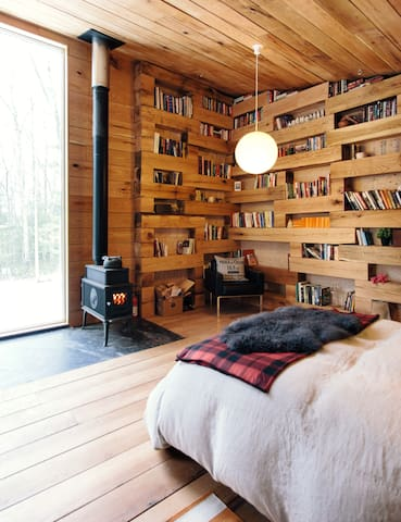 Hemmelig Rom is a simple one-room cabin heated by a wood burning stove and a small electric heater.